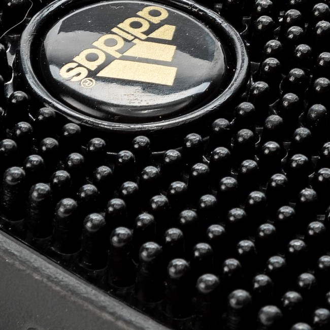 381482c1000b8 Slides adidas - adissage CM7924 Cblack Goldmt Cblack - Clogs and ...
